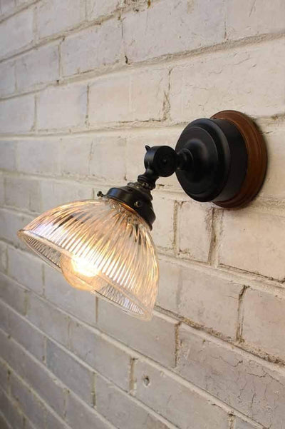 Glass batten wall light has an adjustable swivel joint