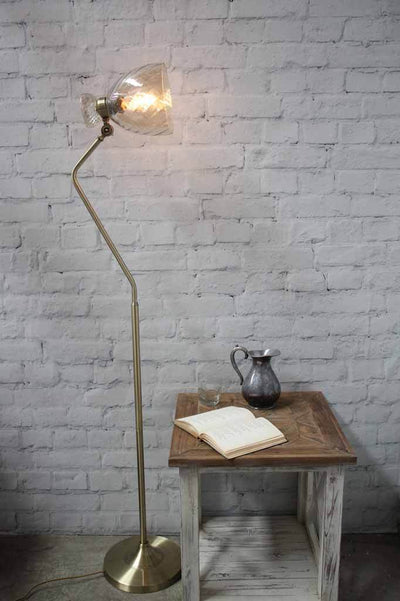 Gold vannes brass floor lamp with tilted amber glass hue shade