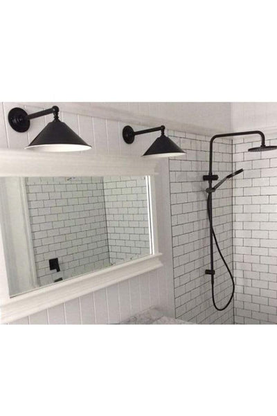Black cone wall light in bathroom