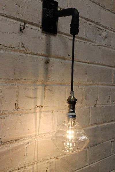 Hanging wall light with diamond light bulb
