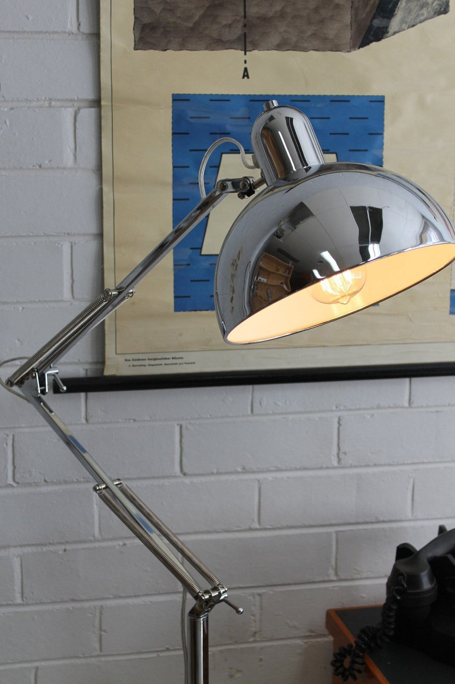 Retro chrome lamp next to office desk