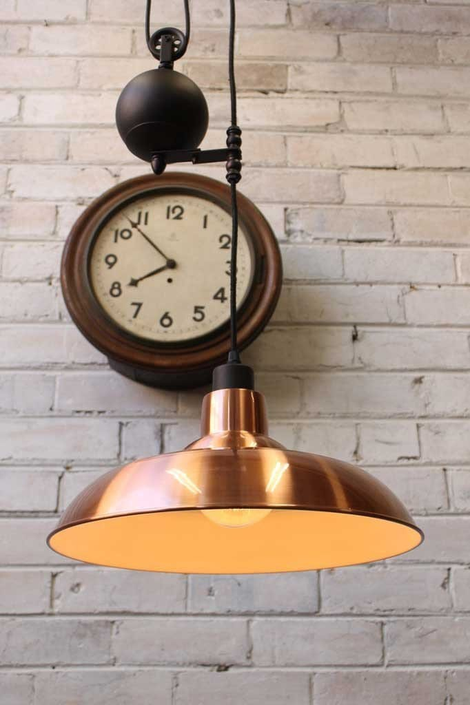 Industrial pulley light with copper shade ideal for kitchen lighting