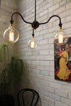 Industrial gooseneck chandelier in cafe restaurant or over dining table