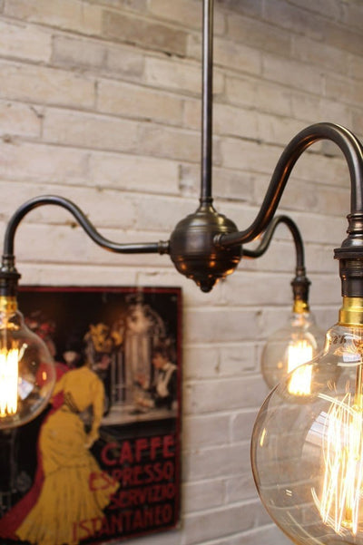 Industrial gooseneck chandelier with bare bulbs