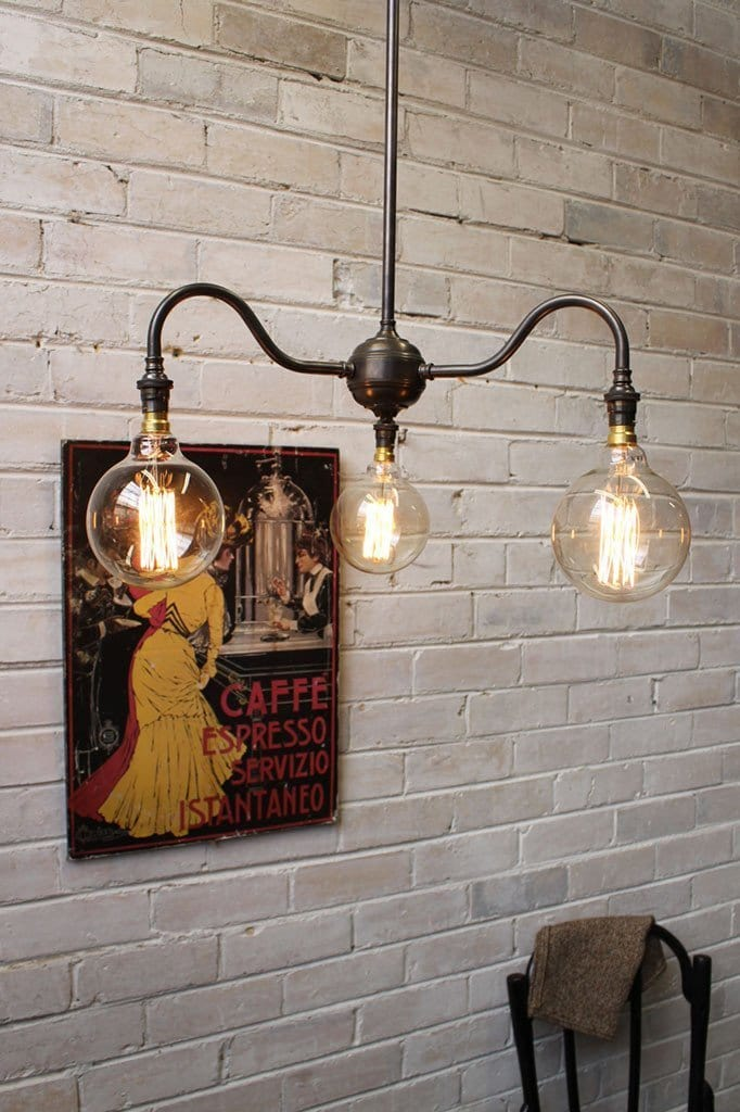 Industrial gooseneck chandelier with filament bulbs
