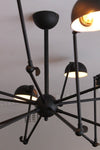 Industrial spider chandelier creates a unique lighting statement.