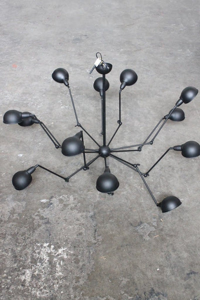 Industrial spider chandelier has 12 arms and shades to illuminate a large interior setting