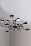 Industrial spider chandelier on ceiling pole mount