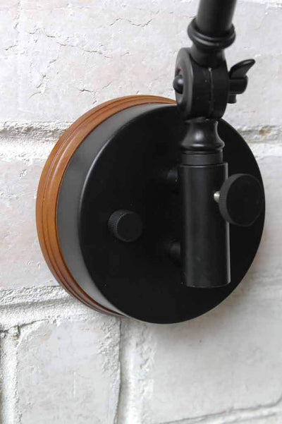Industrial swing arm light with wooden block sconce