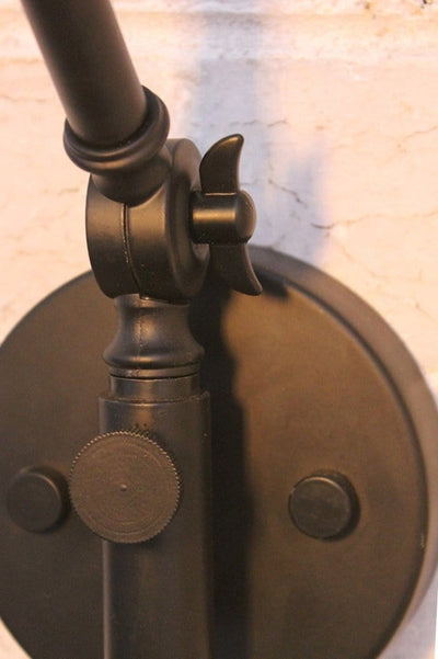 Industrial swing arm wall lamp swivels left and right