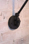 Industrial swing arm wall lamp with matt black sconce