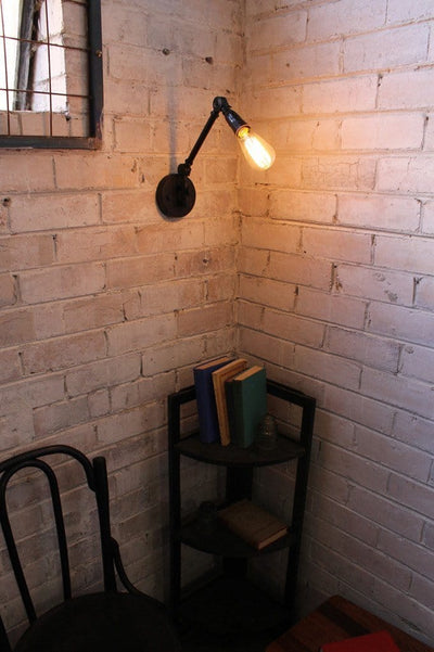 Industrial swing arm wall light can be used for task lighting