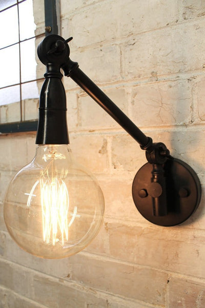 Industrial swing arm wall light with x large squirrel cage edison bulb