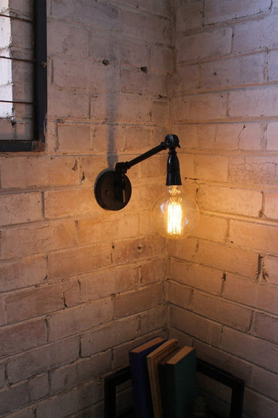 Industrial swing arm wall light with xlarge edison bulb