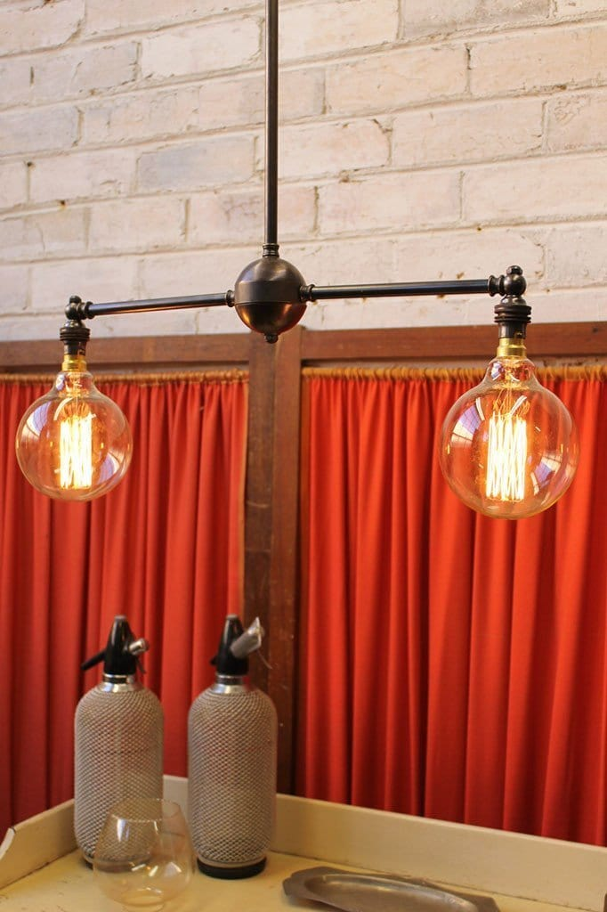 Industrial double arm chandelier in antique bronze