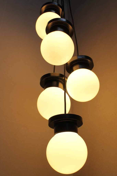 Industrial luxe with classic silhouettes chandelier light. Melbourne based lighting. glass shade balls