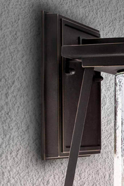 Inlet glass outdoor wall light in a oil rubbed bronze finish.