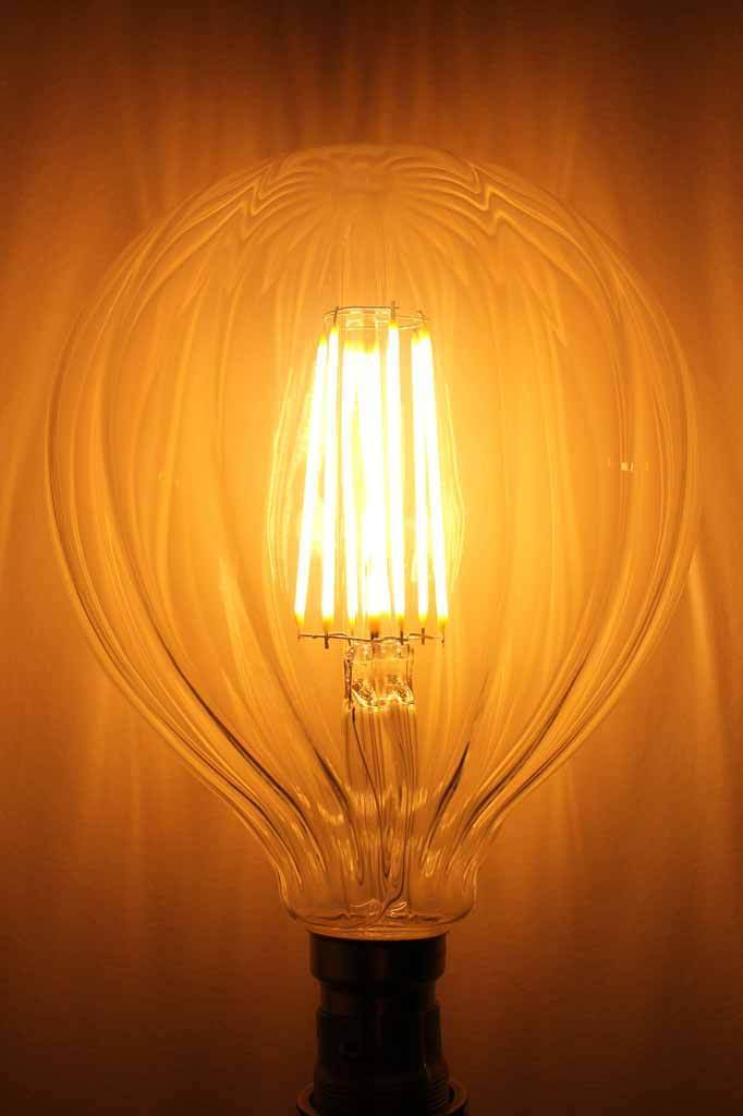 LED Filament Waterfall Light Bulb. The glass of these LED filament bulbs has been crafted with a decorative waterfall pattern
