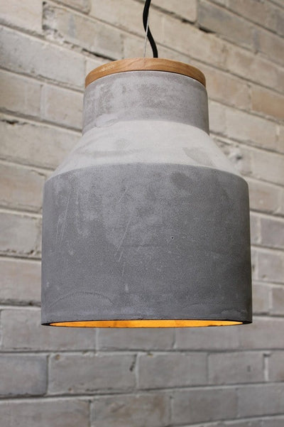 Large concrete timber pendant on suspension cable