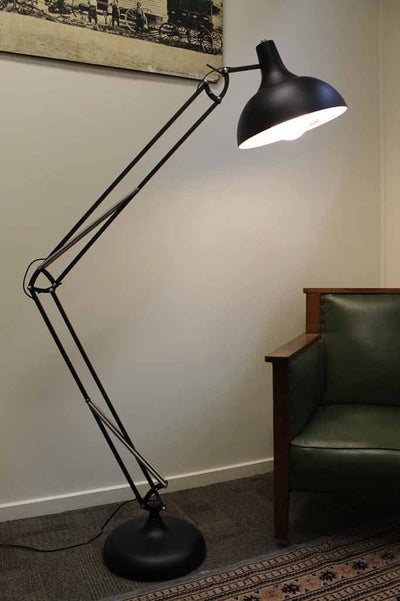 Large metal floor lamp with adjustable arm. black metal to suit most decors. use a led bulb for bright light or glow. ideal for corners or for tasking lighting. online lighting