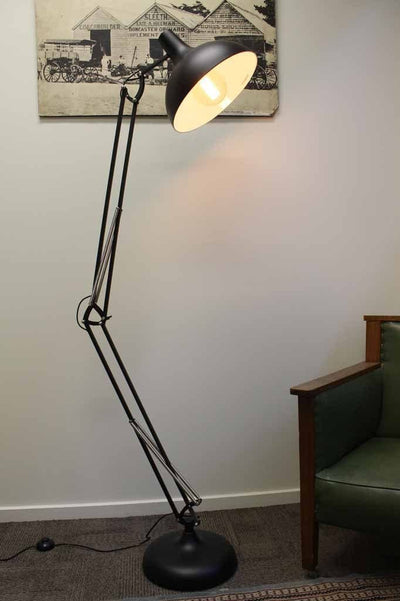 Large metal floor lamp with large arm ideal for lighting a corner in the room or over a chair or table in a kids room