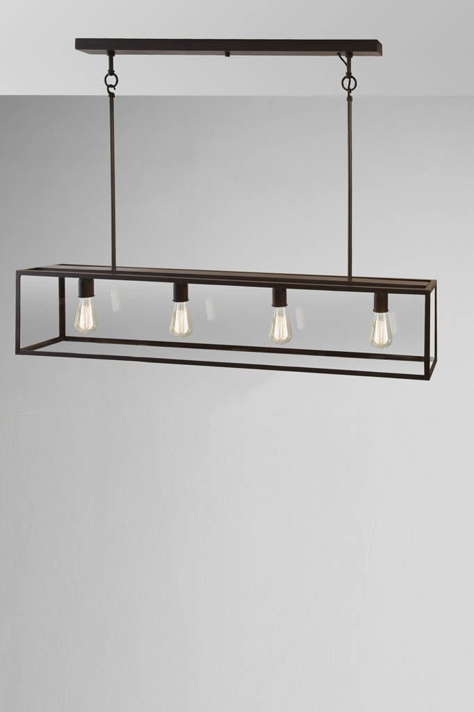 Large modern farmhouse style dover linear glass pendant light with four exposed light bulbs. perfect atop a kitchen island bench.