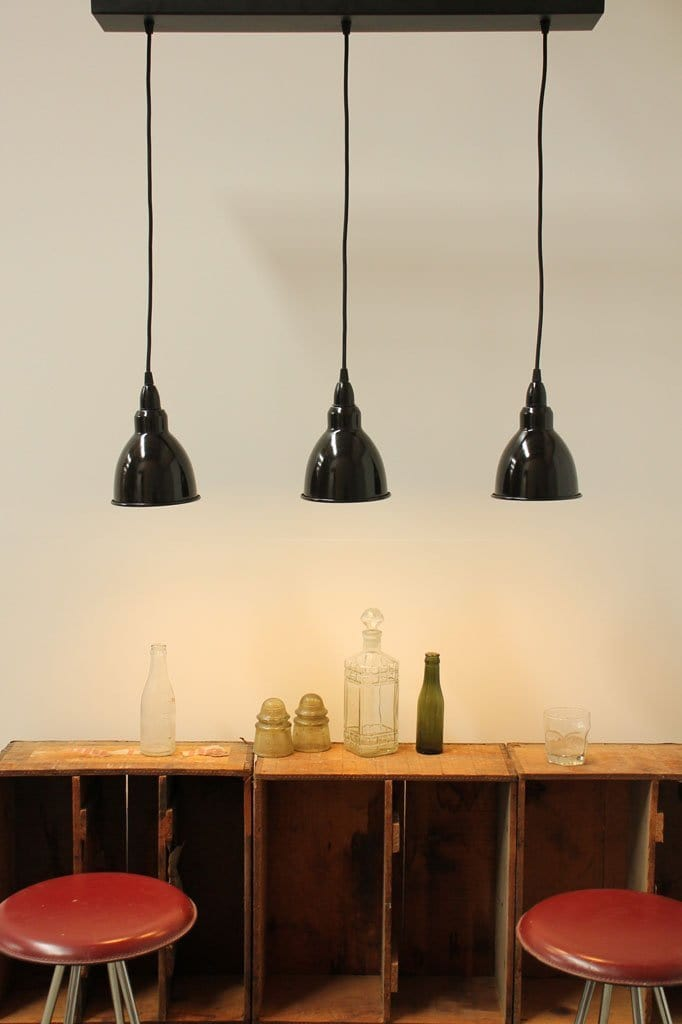 Large multi light pendant. black pendant lights. commercial fitout designs