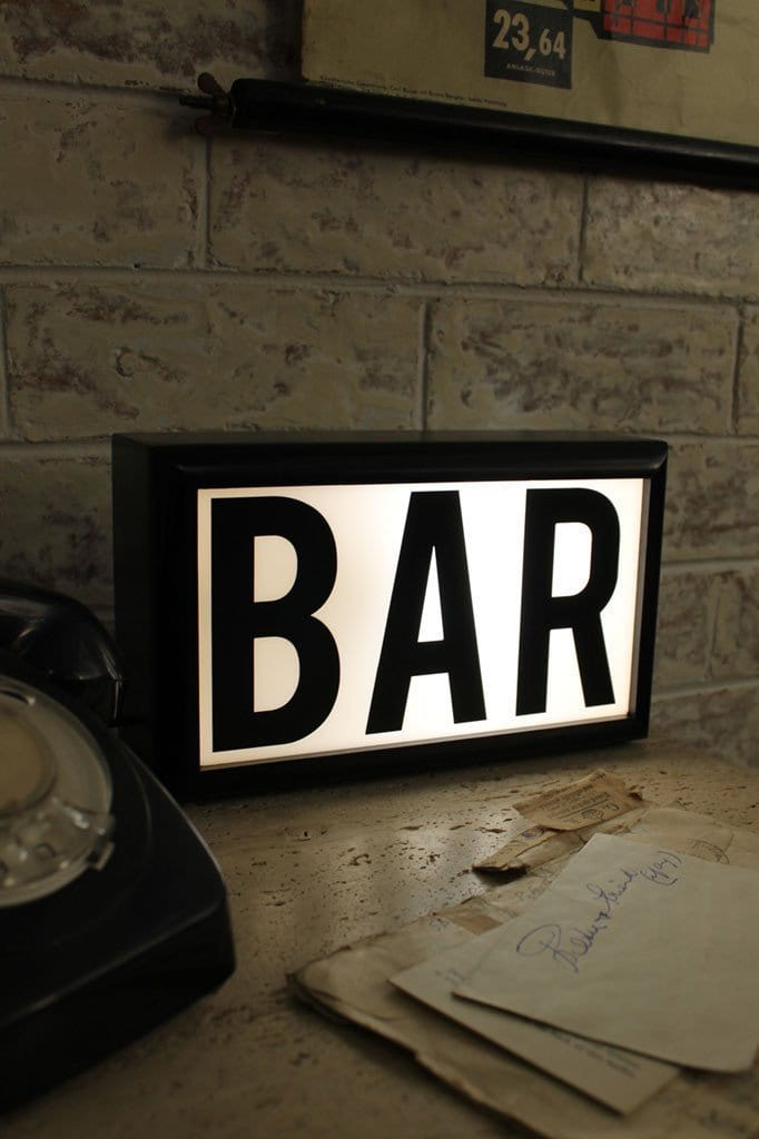 Light boxes bar in vintage industrial setting