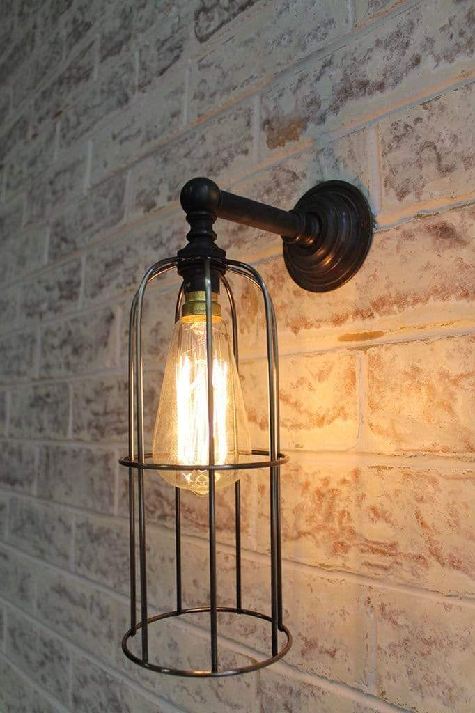 Long cage wall light in dark antique bronze