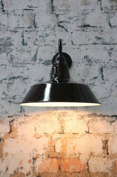 Matt black wall arm and steel shade