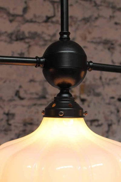 Mayflower 3 light glass pendant blends with robust brass pendant for industrial appeal and sophistication. ideal for modern classic living.
