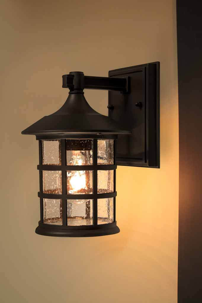 Merchants outdoor light. front or side entrance lighting. dark bronze frame with vintage style clear glass shade.