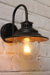 Mews wall light with a quad loop edison filament bulb