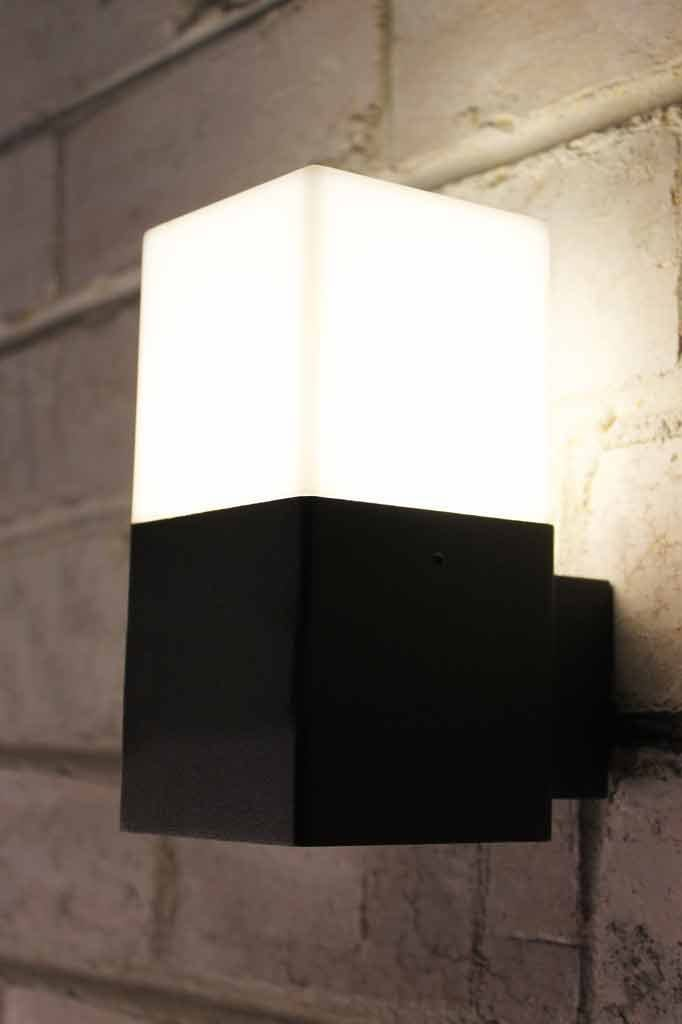Monochrome exterior wall light takes a compact fluorescent bulb