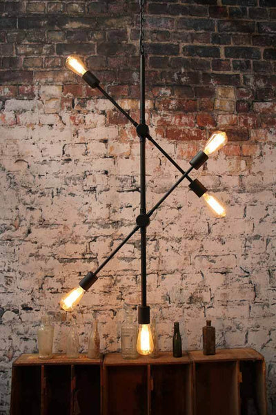 Moveable arm pendant light. matt black finish with exposed bulbs. buy luxe lighting online