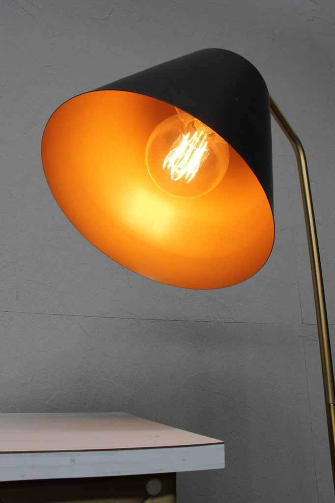 Mid century modern floor lamp. matt black lighting. brushed gold finish lights.