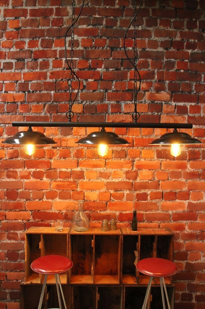 Multi light pendant. industrial style lighting. vintage enamel shades