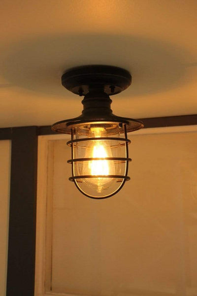 Nautical style ceiling light. flush mount outdoor fitting. cage light for outdoors