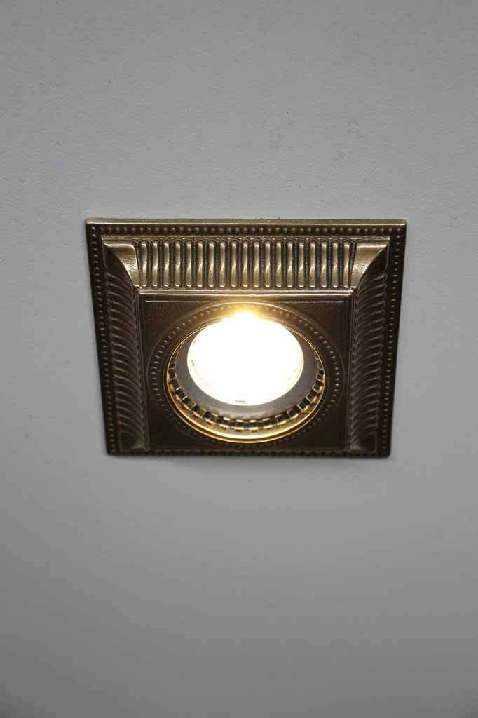 Old brass recessed downlight cover. period style home decor.