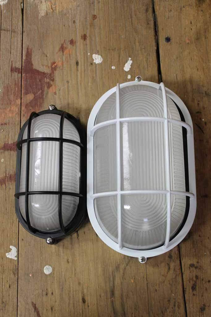 Oval cagaed bunker light small and large black and white