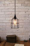 Pendant cage light in black used as a ceiling light above desk