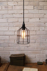 Pendant Cage Light in black used as a ceiling light above desk b96128d8-8d55-451e-b889-513f1d10747d