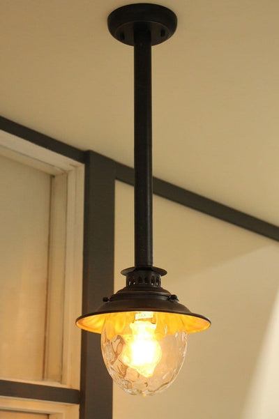 Period outdoor lighting. rod pendant for exterior use. dimpled glass lighting