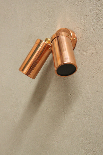 Polished copper outdoor lighting for home. walkway lighting.