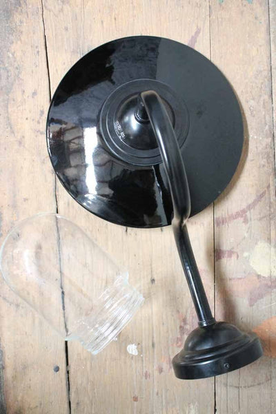 Porcelain enamel glossy black outer with contrasting white inner. comes with glass shade and gooseneck wall sconce
