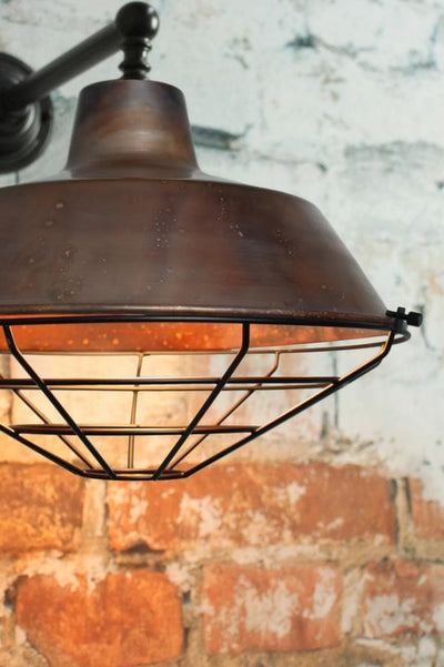 Pure copper wall light with black cage guard