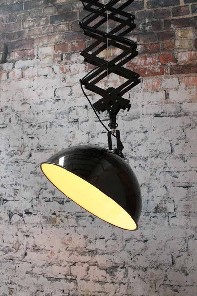 Robust sturdy and large this industrial scissor light has the wow factor that will instantly transform a space with some good old industrial flair. Tilting shade.