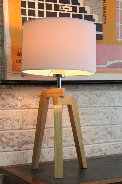 Scandinavian tripod lamp and white fabric shade