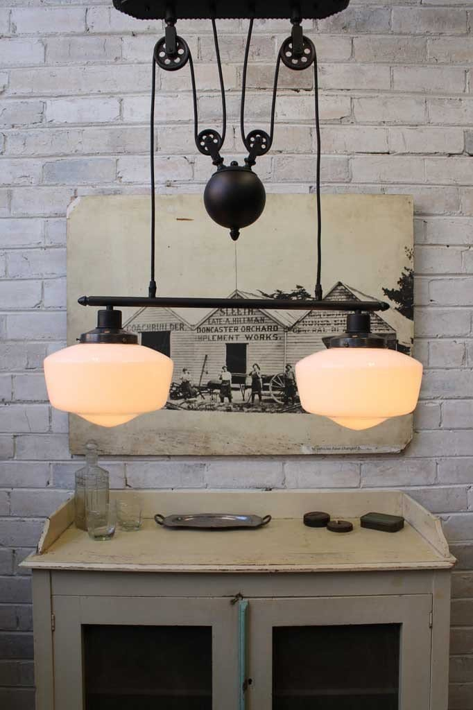 Schoolhouse double arm pulley light with opal glass shades
