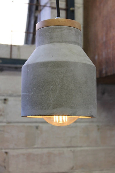 Small concrete timber pendant with protruding bulb